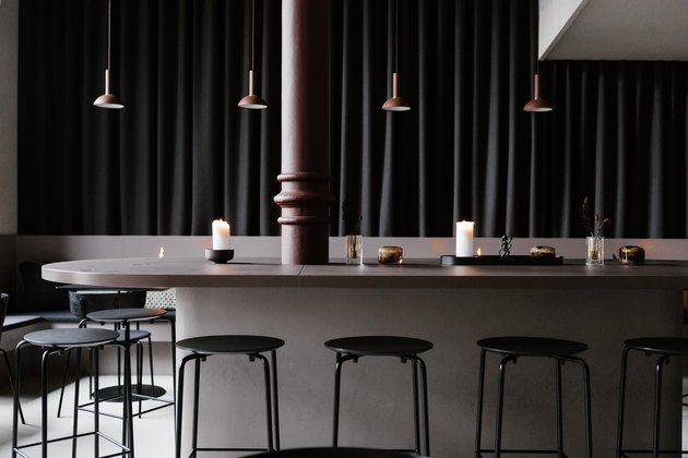 Minimalist bar with brown and black dining furniture and pendant lights