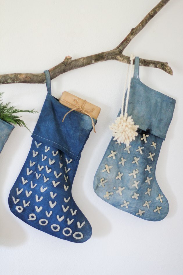 Two indigo stocking and decorative branch