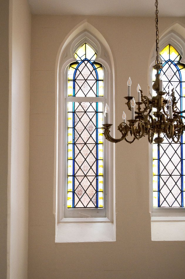 Stained glass windows and a chandelier