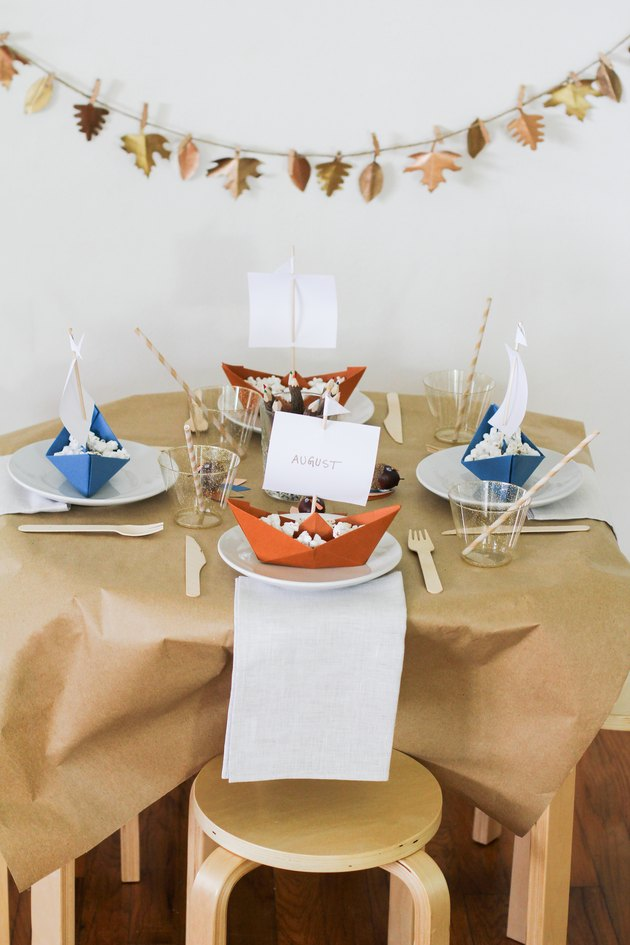 Kids dining table with Thanksgiving decorations and disposable dishware