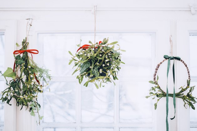 a mistletoe wreath, ball, and traditional hanging cluster all mounted on a ceiing