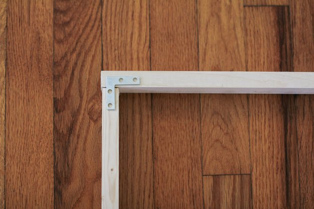 Wood frame with metal flat brace