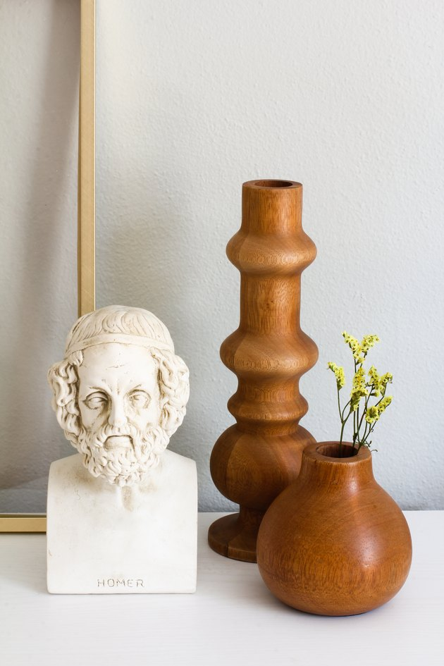 two wooden vases and a small sculptural bust