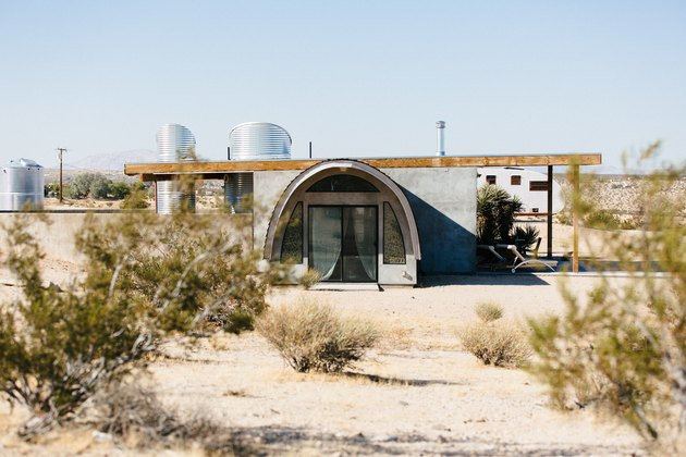 a view of the nearly cylindrical entryway to a desert home