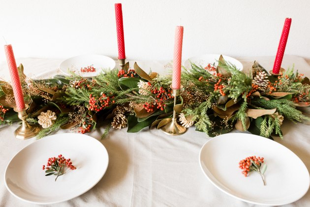 Holiday table with live winter table runner and centerpiece