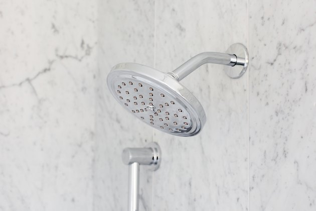 Showerhead in marble shower