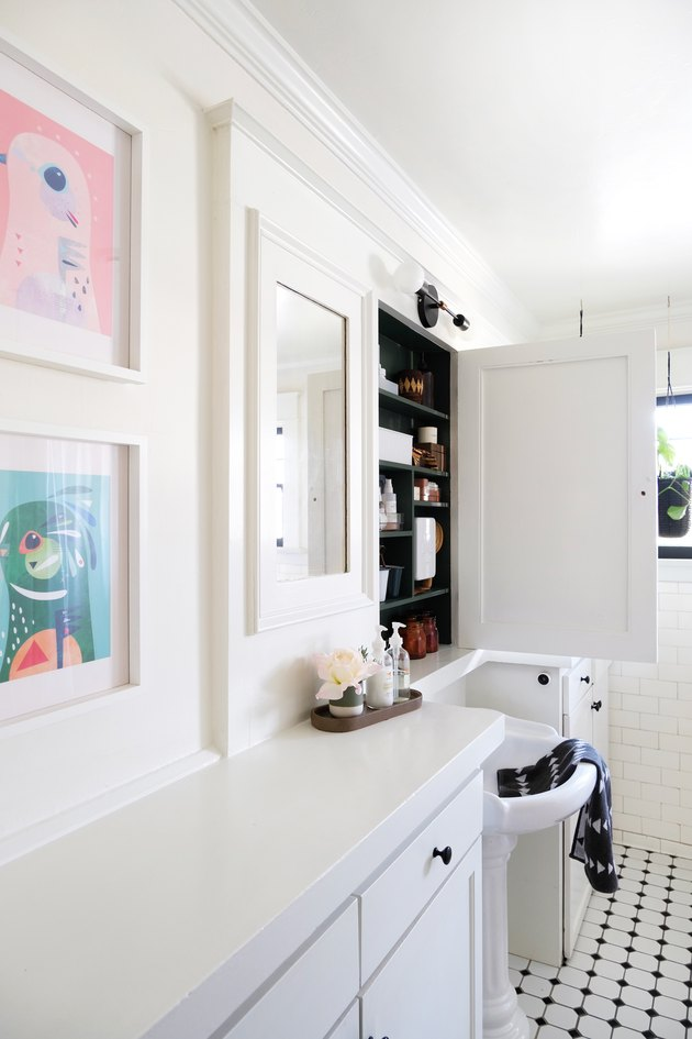 White walled bathroom with black and white tile floor