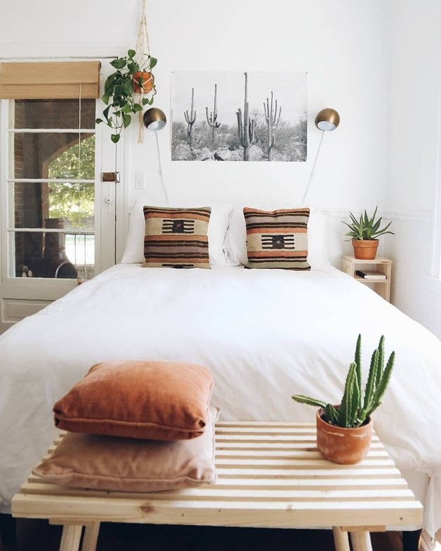 White-dominant minimal bedroom with southwestern accents