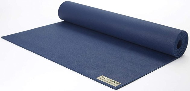 The Jade Yoga Harmony is an eco-friendly yoga mat made from natural rubber, which gives it a strong grip and optimal traction. Perfect for advanced yogis or beginners, this mat provides just enough support with 3/16 inches (around 4.8 millimeters) of thickness. And with a weight of 4.2 pounds, it's lightweight enough to bring on the go.