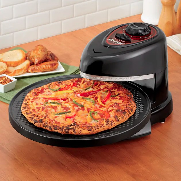 Designed as an indoor pizza oven that sits on your kitchen counter, you place the pizza on the circular tray that turns between a pair of over and under heating elements, ensuring a consistent bake. It's perfect for those who aren't looking a big commitment — it can be tucked away when not in use and clocks in at under $50.