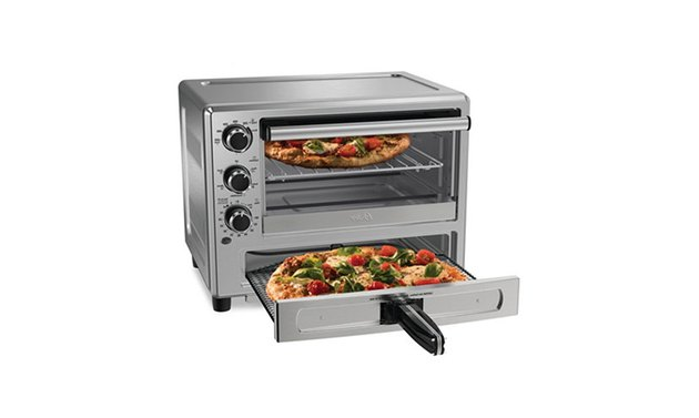 Oster's pizza drawer only reaches about 400 degrees, so don't expect beautifully charred homemade pizza crust. But the tradeoff is that you get a full-featured convection toaster oven and pizza drawer — both of which can operate at the same time — for one very affordable price and one relatively small footprint on your counter. It measures about 15.5 inches by 18 inches, and stands 10 inches high.