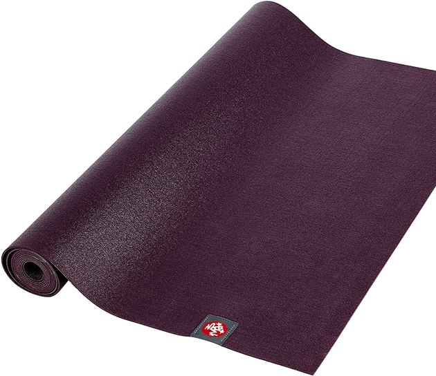 When you want to practice yoga while you travel, a lightweight yoga mat is key. The Manduka eKO Superlite Travel Yoga Mat is designed for taking yoga on the road with 1.5 millimeters of thickness and a light weight of only 2.2 pounds. Not only is it travel-friendly, but it also has a rippled and textured surface for traction and support.
