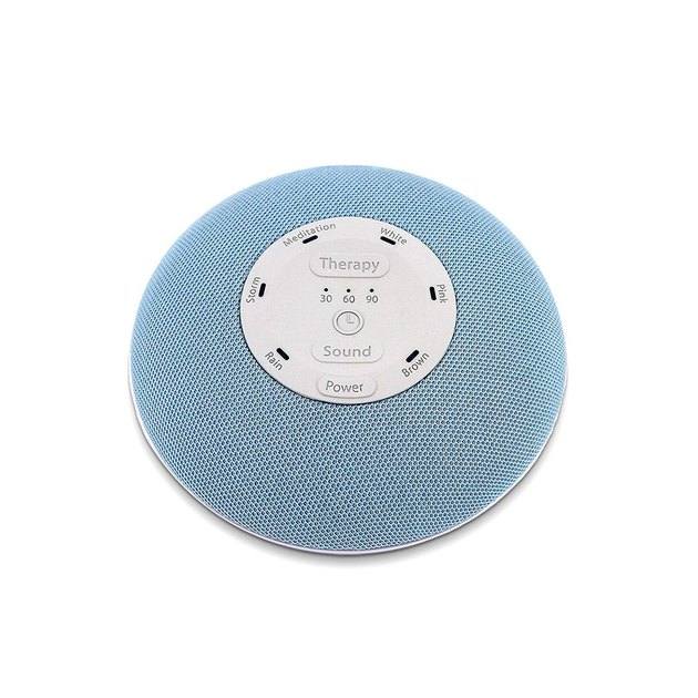 """Measuring just over 4"""" in diameter, you can easily slip this portable sound machine into your carry-on, making it the perfect companion for noisy hotel rooms."""