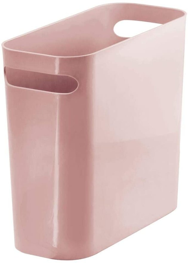 Sleek, small, and stylish, this wastebasket by mDesign can be tucked away in bathrooms, under the sink, dorm rooms, and more. They're easy to clean and made of shatter-resistant plastic. These wastebaskets look so good, you can even use them as storage bins.