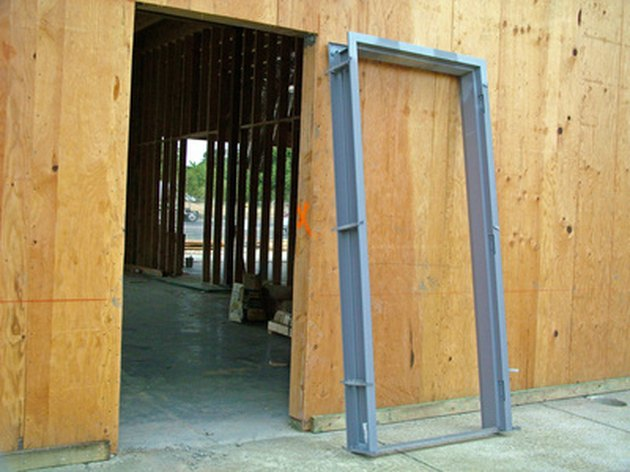 How to Sheetrock Around a Door Frame