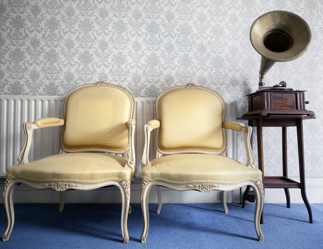 two yellow silk chairs and a gramophone
