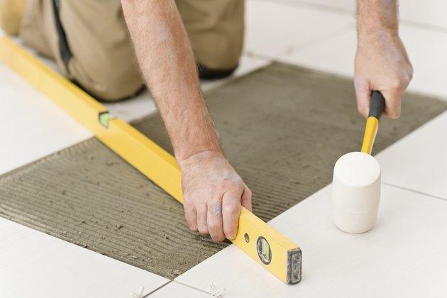 Home improvement, renovation - handyman laying tile