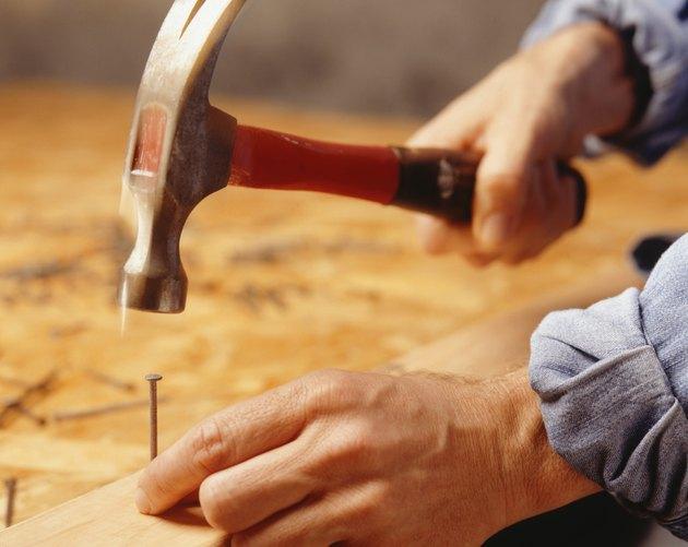 Man hammering nail, (Close-up)