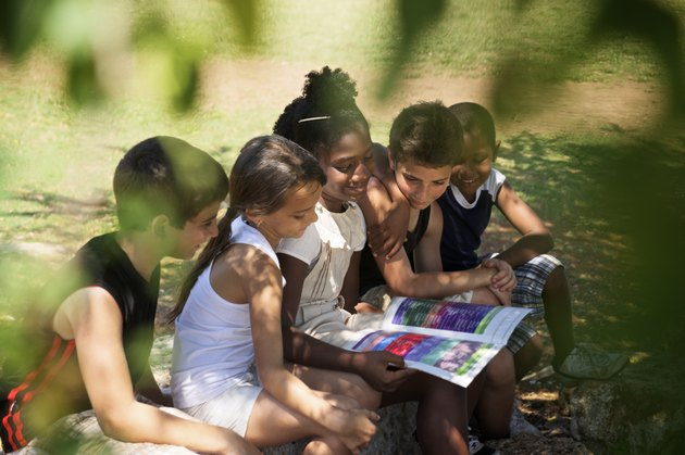 """Children and education, kids reading book in park"""