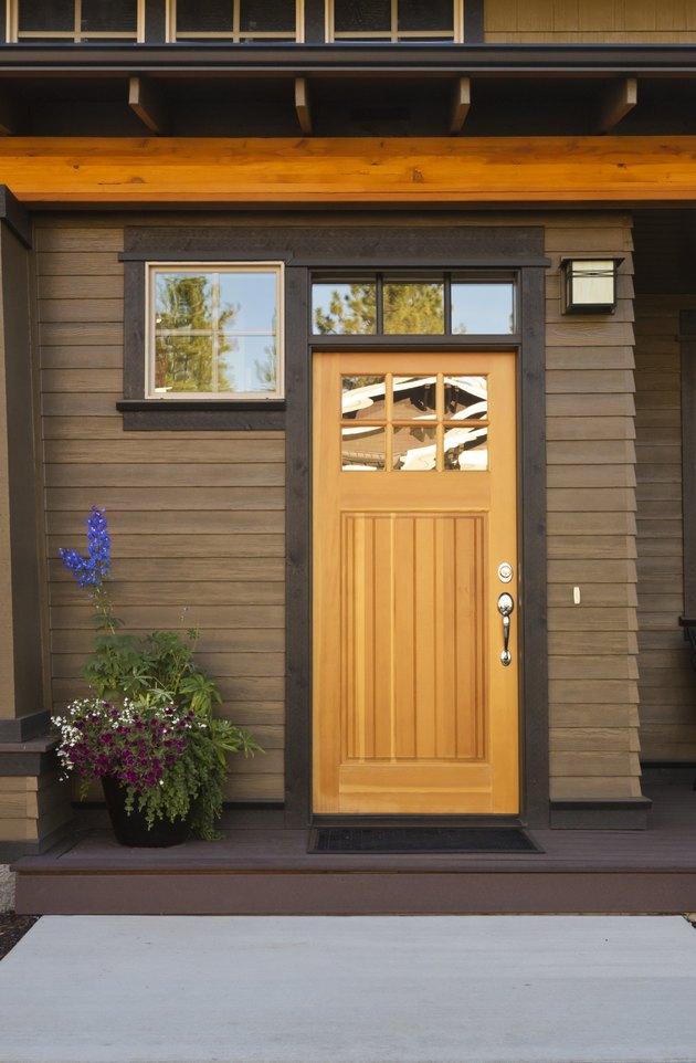 Rustic front door of an upscale home