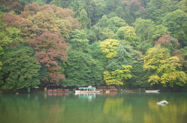 """Boats on Katsura river at fall in Arashiyama, Japan"""