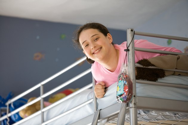Smiling girl lying on bunk bed