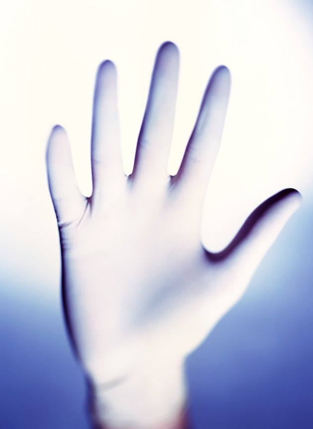 close-up of a hand wearing a latex glove