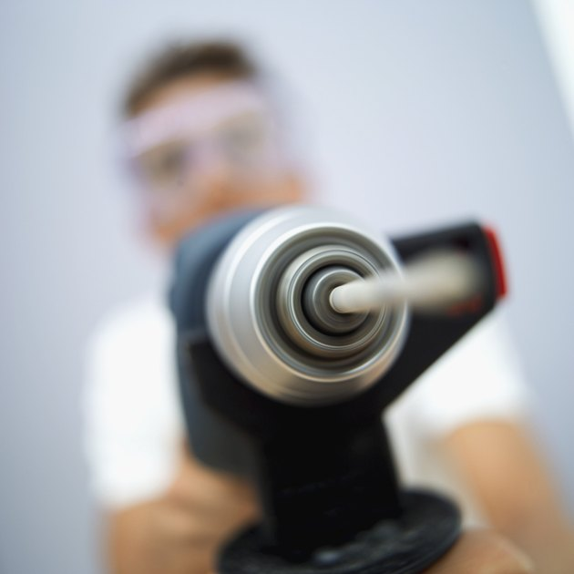 young man holding a drill machine