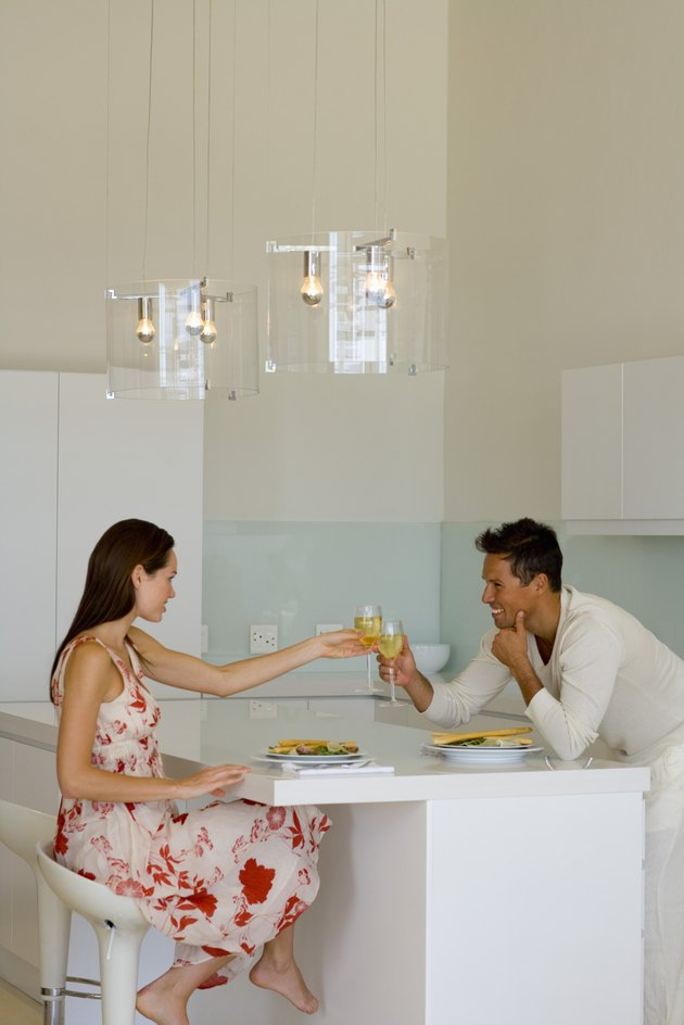 Man and woman toasting over salad