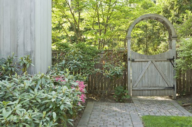 Yard with brick walkway and wooden gate