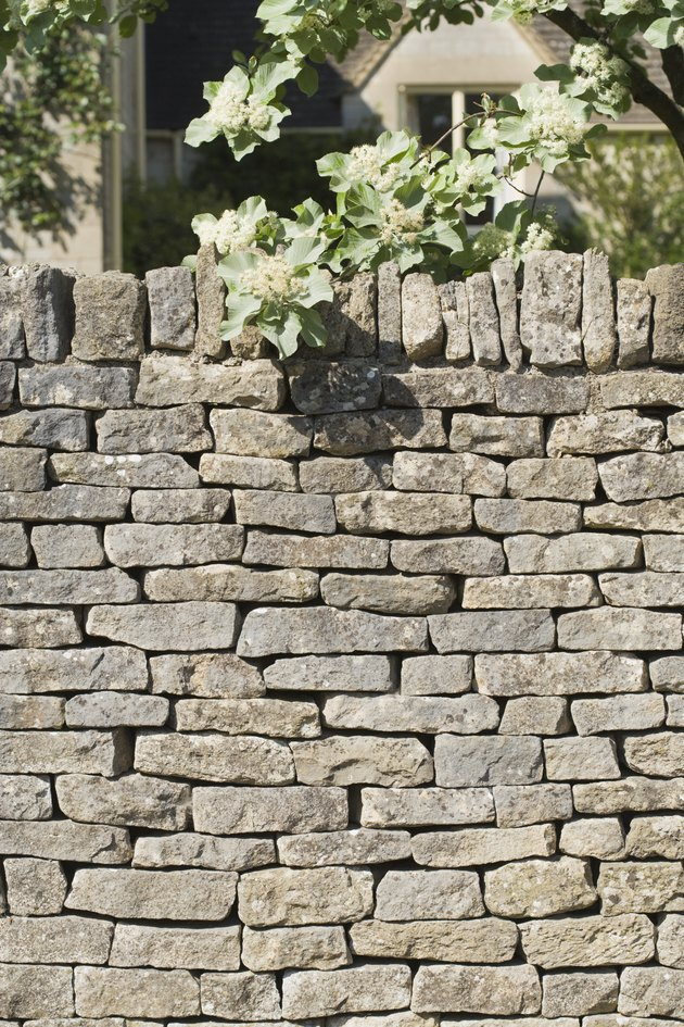 Stone wall covering house
