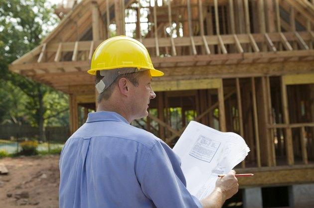 Contractor reading blueprint