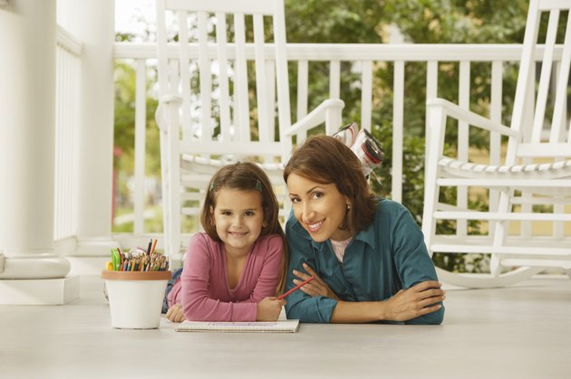 Hispanic mother and daughter coloring