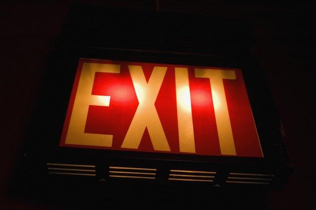 A close-up of backlit exit sign