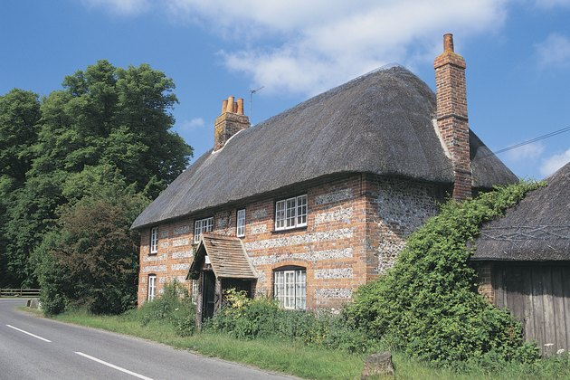 Brick and flint rock house with thatched roof