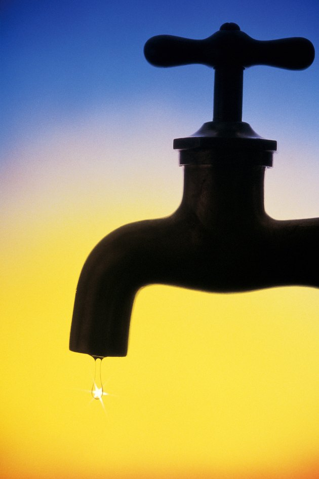 Dripping faucet in silhouette