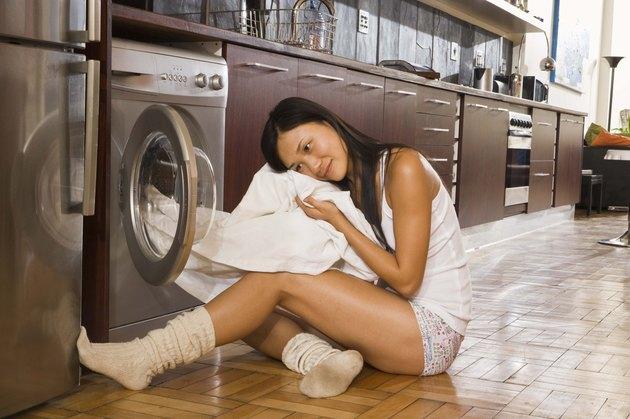 Woman unloading linen dryer