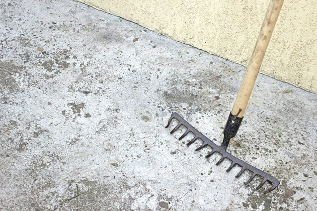 Rake tool over concrete background