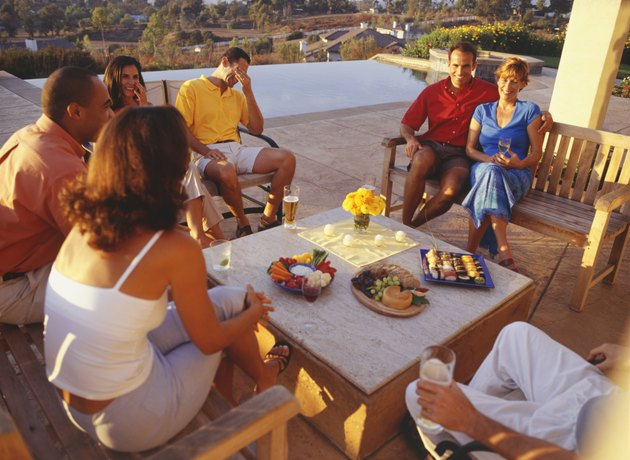 Group of friends having patio meal on vacation