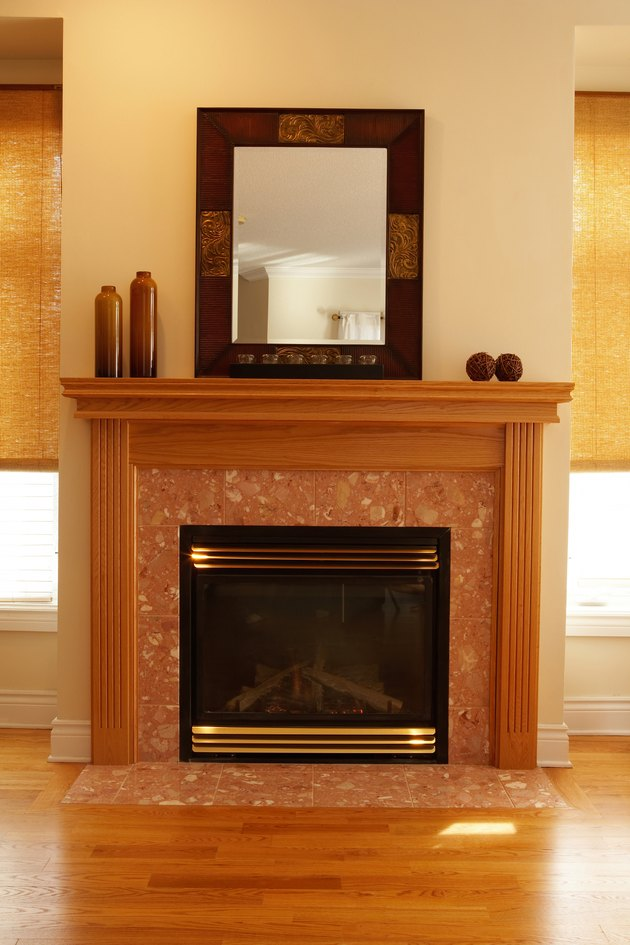 Fireplace with decorative vases and mirror