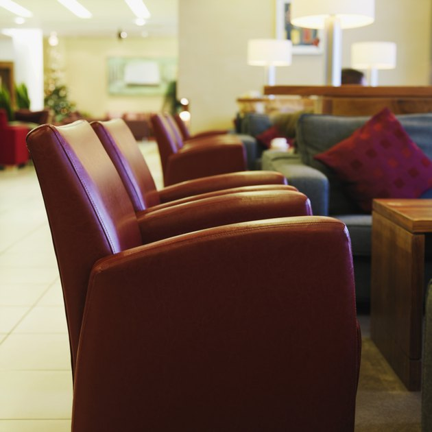 Side view of leather armchairs in hotel foyer