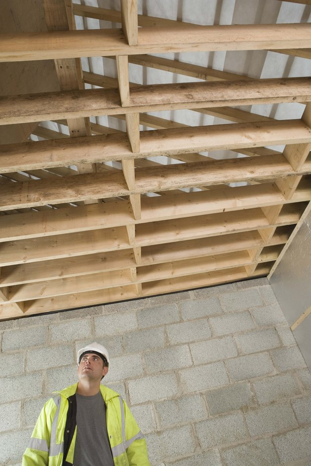 Construction worker looking at rafters