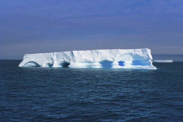 Flat iceberg floating at Antarctic Peninsula