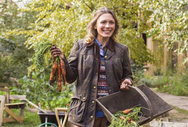 Beautiful woman with a bunch of carrots