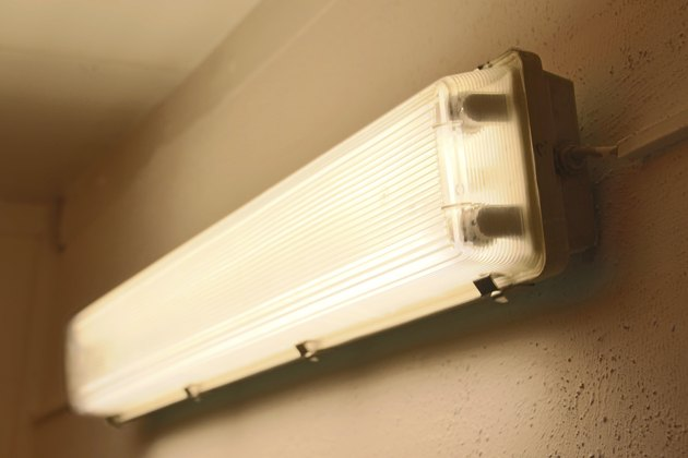 very old used fluorescent tube lamp