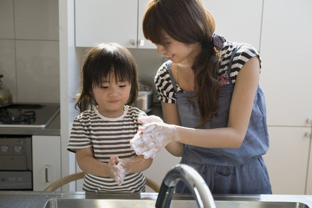 Mother and Son Washing Hands