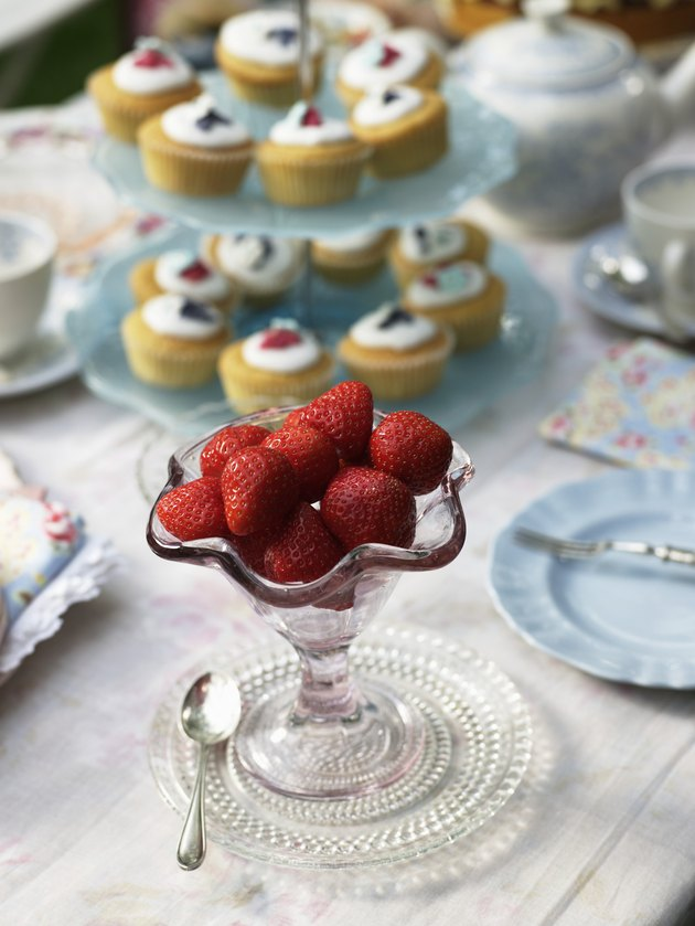 Strawberries in stemmed glass bowl, close-up