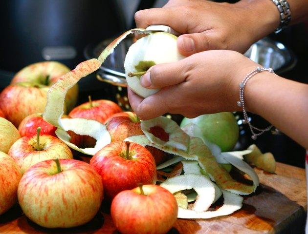 051 Woman peeling red apples in kitchen.jpg
