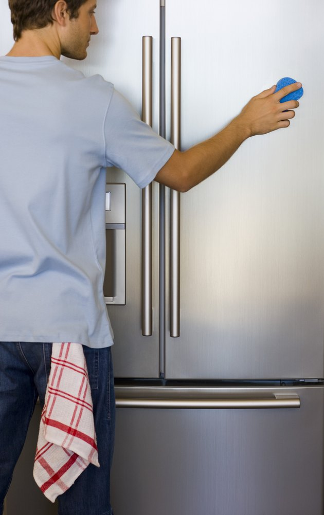 Man cleaning refrigerator