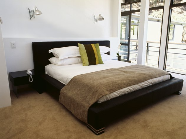 pillows on a double bed in the bedroom
